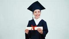 Portrait happy student graduate girl 7-8 years in mantle holding and rejoices Stock Footage
