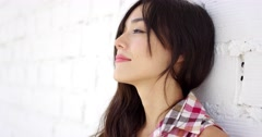 Serene woman with long brown hair stares at camera - stock footage