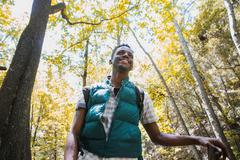 Young male hiker hiking in forest, Arcadia, California, USA - stock photo