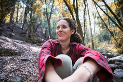 Young female hiker sitting in forest, Arcadia, California, USA - stock photo