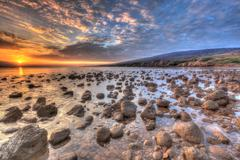 Rocky Shore near Kaleahi at sunrise, North Shore, Lanai Island, Hawaii, USA - stock photo