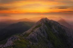 Hazy sunset in Anboto mountain range Stock Photos