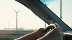 Driving By an Industrial Zone - Wind Farm Stock Footage