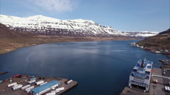 Aerial Of Snowcap Mountains And Blue Water In Seyðisfjörður Stock Footage