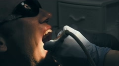 Mid age man gets medical teeth removing calculus Stock Footage