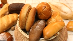Bread in the rotating basket on a table Stock Footage