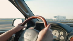 Driving Safe with Hands Firmly Holding the Steering Wheel Stock Footage