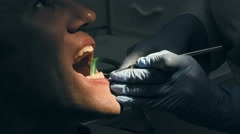 Man gets dental medical examination and treatment - stock footage