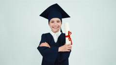 Portrait happy student graduate girl 7-8 years in mantle holding her diploma - stock footage
