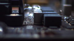 Sweep across a computer's motherboard as it fills with liquid. Slow motion. Stock Footage