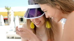 happy female friends in swimsuits using smartphone, watching photos or news - stock footage