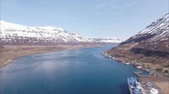 Aerial Of Snowcap Mountains And Blue Water In Seyðisfjörður Stock Footage