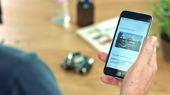 Using the Airbnb App on iPhone 6s to find vacation lodge Stock Footage
