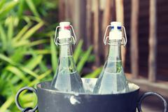 couple of water bottles in ice bucket at hotel - stock photo
