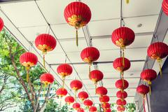 ceiling decorated with hanging chinese lanterns - stock photo