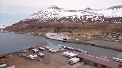 Aerial Of Dock In Seyðisfjörður With Snow Cap Mountian In View Stock Footage