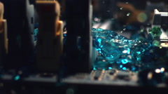 Blue liquid rushes over a computer's motherboard like a tsunami. Stock Footage