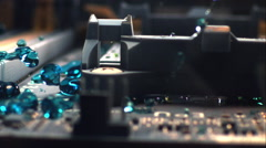 Tracking macro shot through circuit as water droplets rain down and bounce off. Stock Footage