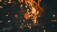The angular grinding machine is cutting the pipe and flying a lot of sparks  Stock Footage