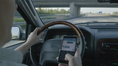 Man Texting on His Phone While Driving on a Busy Road Arkistovideo