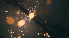 Welding works on a black background and a lot of sparks flying around Stock Footage