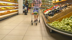 Guy walking with shopping trolley at store Stock Footage