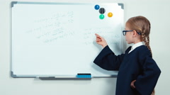 Very smart nerd with glasses standing near whiteboard smiling at the camera Stock Footage