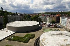 KARLOVY VARY, CZECH REPUBLIC - JULY 3: People walk on streets of spa town Kar Stock Photos