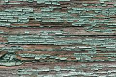 Old shabby wooden planks with cracked color paint Stock Photos