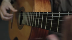 Man masterfully plays on classical acoustic guitar in the dark room close-up Stock Footage