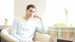 Bored, tired man sleeping at sofa at his work space - stock footage