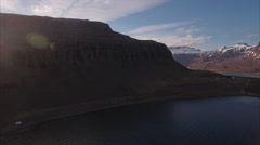 Aerial Shot Of Sunset Mountain Silhouette In Iceland With Icecap Mountain Stock Footage