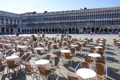 The expensive and exclusive street cafes in Venice on St Marks Square Stock Photos