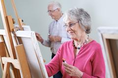 Seniors Attending Painting Class Together Stock Photos