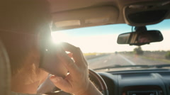 Man Talking on the Phone While Driving Arkistovideo