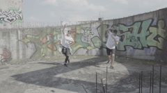 Active young couple dancing hip hop choreography in an abandoned building  Stock Footage