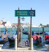Famous Gondola service in the canals of Venice - VENICE, ITALY - JUNE 29, 201 - stock photo