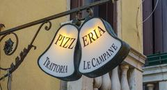 Pizzeria in the streets of Venice - VENICE, ITALY - JUNE 30, 2016 - stock photo