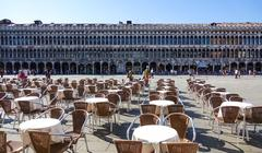 The expensive and exclusive street cafes in Venice on St Marks Square - stock photo