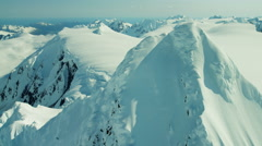 Aerial view of rugged glacial mountains and snow in Alaska America Stock Footage