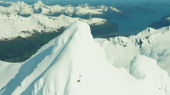 Aerial view of frozen rock and snow covered mountains Alaska America Stock Footage