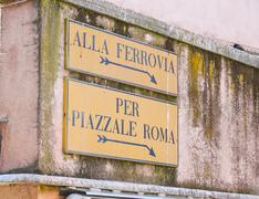 Street sign to Railway station and Piazzale Roma Stock Photos