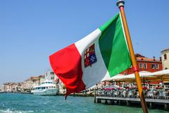 Italian Flag attached to a boat in Venice - VENICE, ITALY - JUNE 30, 2016 Stock Photos