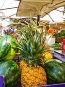 Melon and Pineapple fruits at a street market - VERONA, ITALY - JUNE 30, 2016 - stock photo