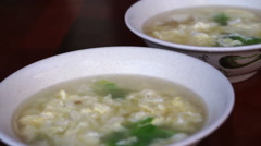 Chinese, Taiwanese plain food, egg scramble with boiled rice hot soup - stock footage