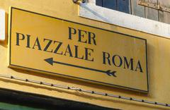 Direction sign to Piazzale Roma in Venice - VENICE, ITALY - JUNE 30, 2016 - stock photo