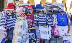 Souvenir sale in the city of Venice - VENICE, ITALY - JUNE 30, 2016 - stock photo