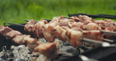 Pork shashlik over coals on brazier Stock Footage