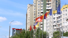 International flags of several countries waving in the wind on the balcony of a  Stock Footage