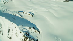 Aerial view of rugged snow covered mountains Alaska USA Stock Footage